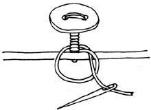 最後の輪に糸を通す